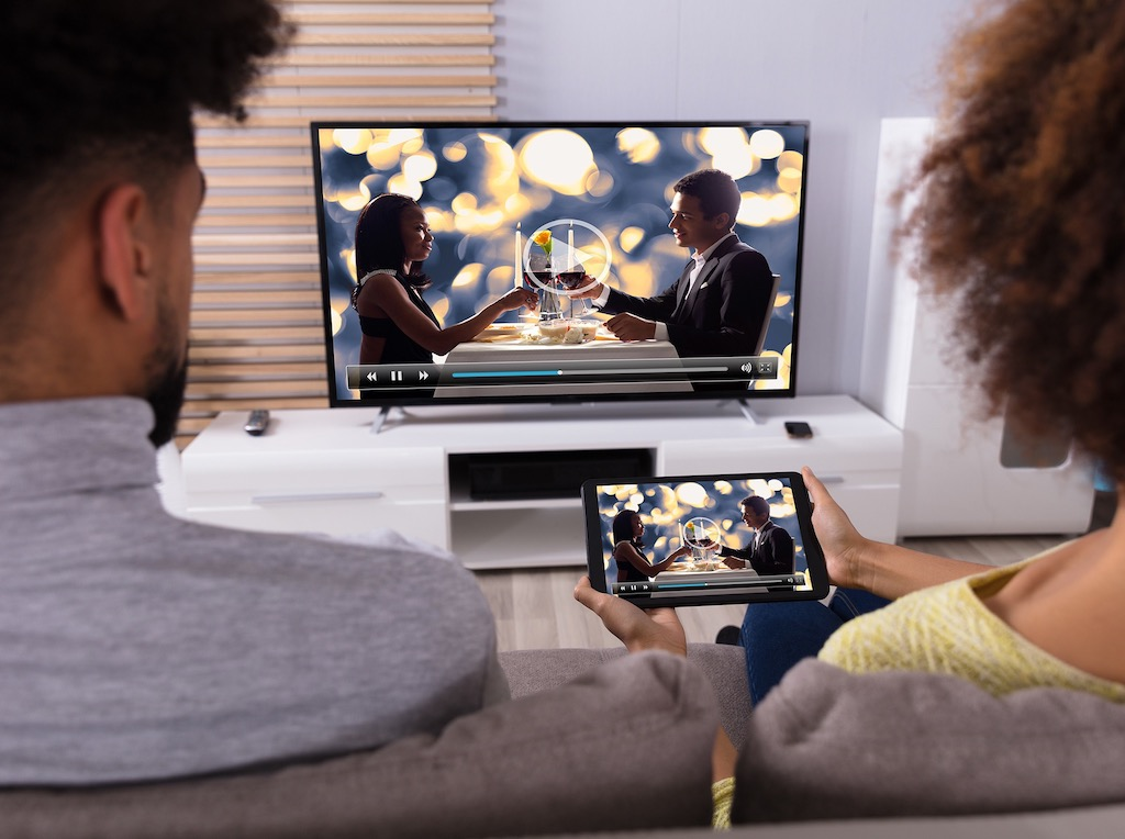 Couple Enjoying movie after Video Streaming Device Setup